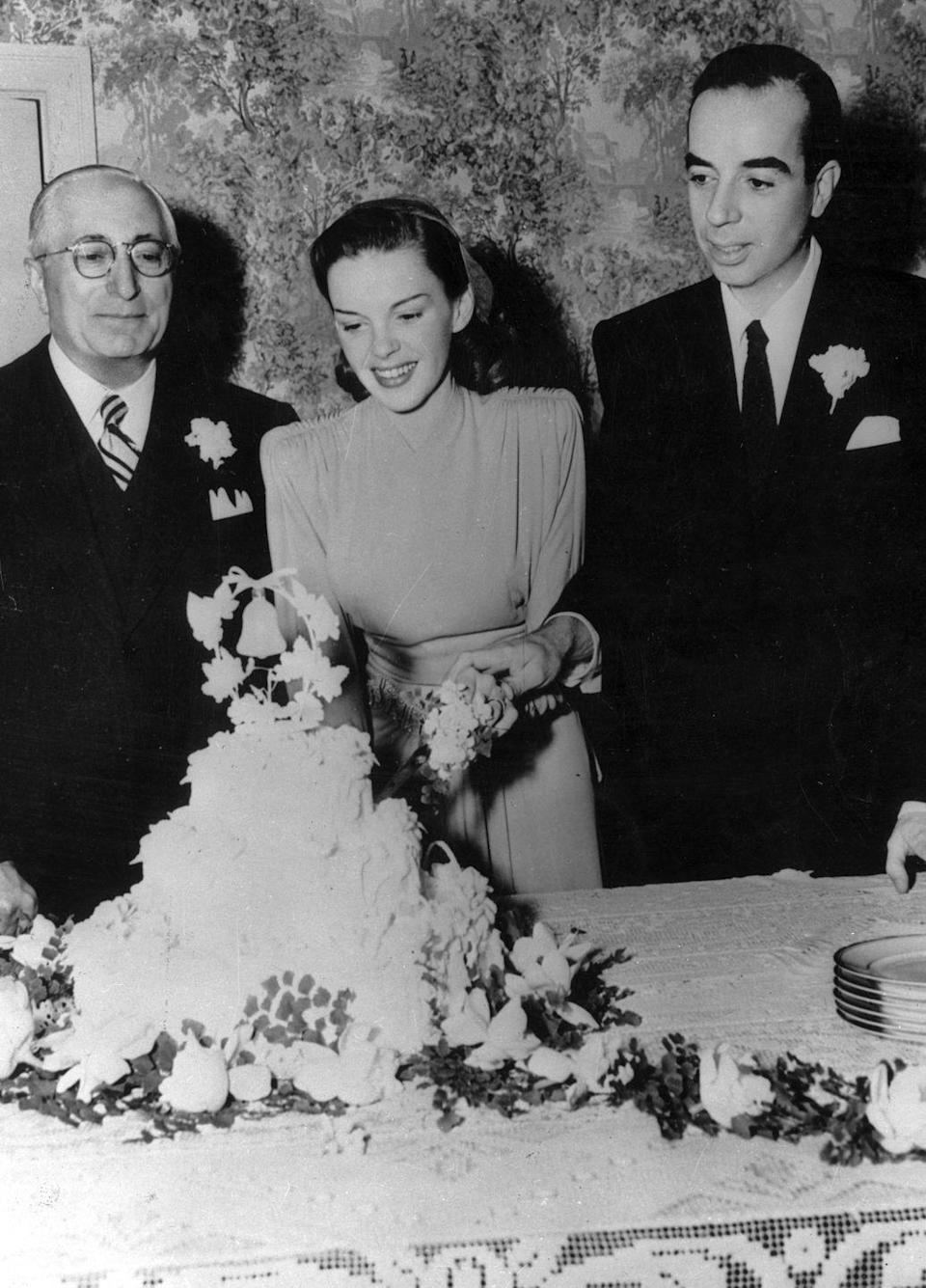 <p>Director Vincente Minnelli and actress Judy Garland cut the wedding cake after their nuptials in 1945. The marriage was the second of five for <em>The Wizard of Oz</em> starlet, and the first of four for the Academy Award-winning director. They divorced in 1951.<br></p>