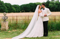 <p>The former 'Made In Chelsea' star wore a bespoke Halfpenny London dress for her wedding to Hugo Taylor. Made from French lace, spotty tulle and silk organza, the gown boasted double bubble sleeves and a long, plain veil. <em>[Photo: Instagram/Millie Mackintosh]</em> </p>