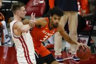 Illinois's Jacob Grandison tries to get past Wisconsin's Tyler Wahl during the second half of an NCAA college basketball game Saturday, Feb. 27, 2021, in Madison, Wis. (AP Photo/Morry Gash)
