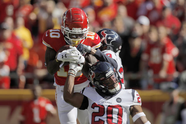 Kansas City Chiefs wide receiver Tyreek Hill (10) makes a touchdown catch over Houston Texans safety Justin Reid (20) as cornerback Phillip Gaines (29) watches, during the first half of an NFL football game in Kansas City, Mo., Sunday, Oct. 13, 2019. (AP Photo/Colin E. Braley)