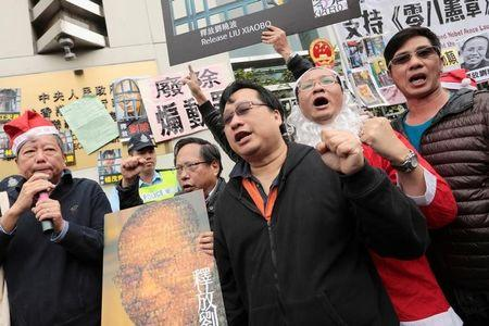 Nobel Peace Prize laureate Liu Xiaobo during a protest to urge for the release of Liu outside the Chinese liaison office in Hong Kong
