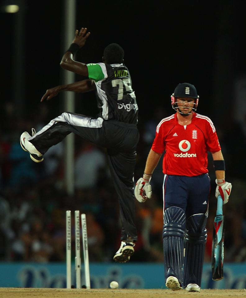 ST. JOHN'S, ANTIGUA AND BARBUDA - NOVEMBER 01:  Ian Bell of England is bowled out by Jerome Taylor of Superstars during the Stanford Twenty20 Super Series 20/20 for 20 match between Stamford Superstars and England at the Stanford Cricket Ground on November 1, 2008 in St Johns, Antigua  (Photo by Tom Shaw/Getty Images)