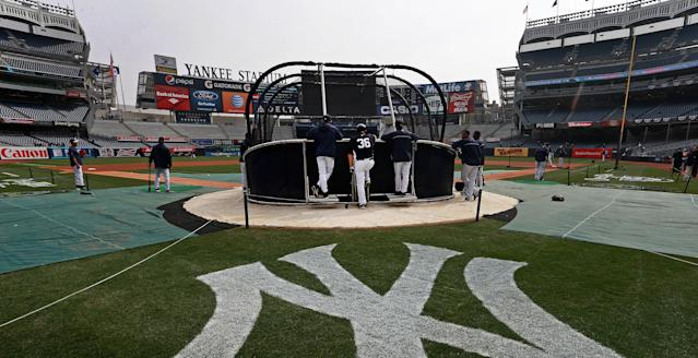 "The <a class=""link rapid-noclick-resp"" href=""/mlb/teams/ny-yankees/"" data-ylk=""slk:Yankees"">Yankees</a> made history by hiring a women as a full-time hitting coach. (Photo by Jim Davis/The Boston Globe via Getty Images)"