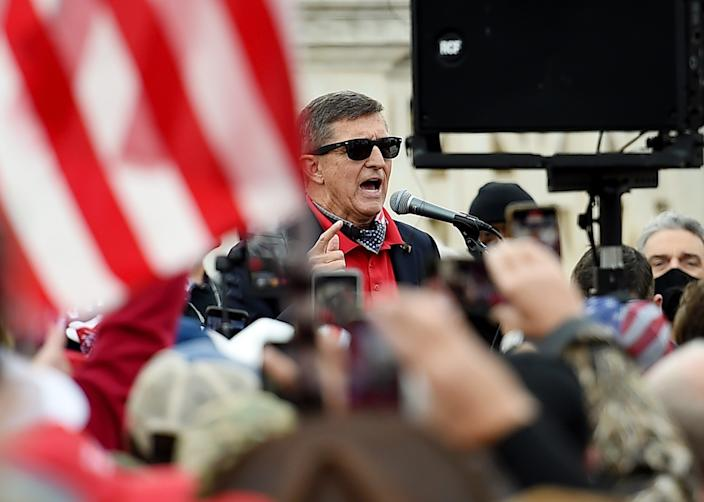 <p>Former US National Security Advisor Michael Flynn speaks to supporters of US President Donald Trump during the Million MAGA March to protest the outcome of the 2020 presidential election in front of the US Supreme Court on December 12, 2020 in Washington, DC</p> (AFP via Getty Images)