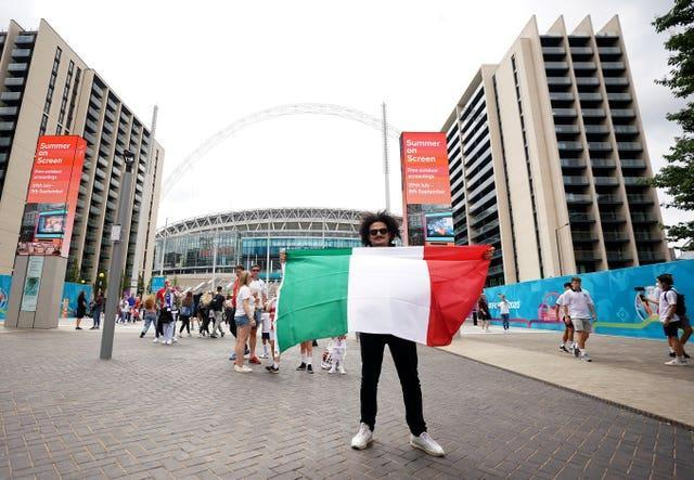 An Italy fan outside the ground