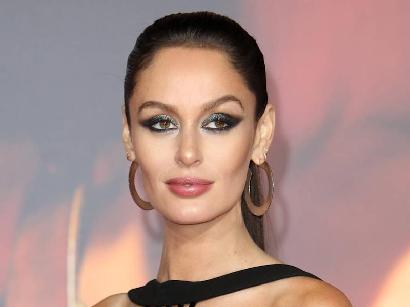 Nicole Trunfio working on a book about pregnancy experiences