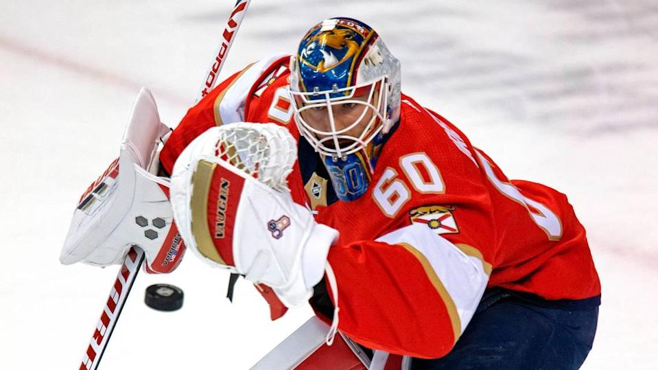 Florida Panthers goalie Chris Driedger (60) blocks a shot during warmups before the start of the Florida Panthers NHL home opener game against the Chicago Blackhawks at the BB&T Center on Sunday, January 17, 2021 in Sunrise, Fl.