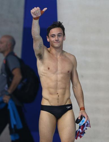 Tom Daley in Speedos giving a thumbs-up