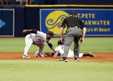 Jul 11, 2018; St. Petersburg, FL, USA; Tampa Bay Rays right fielder Mallex Smith (0) steals second base as he slides in safe and Detroit Tigers shortstop Ronny Rodriguez (60) attempted to tag him out during the eighth inning at Tropicana Field. Mandatory Credit: Kim Klement-USA TODAY Sports