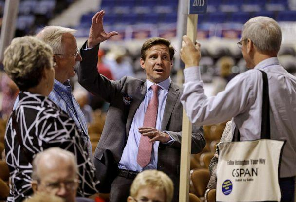 PHOTO: Candidate for Governor of Virginia, Pete Snyder, center, gestures as he talks to delegates during the opening of the Virginia Republican convention in Richmond, Va., May 17, 2013. (Steve Helber/AP, FILE)