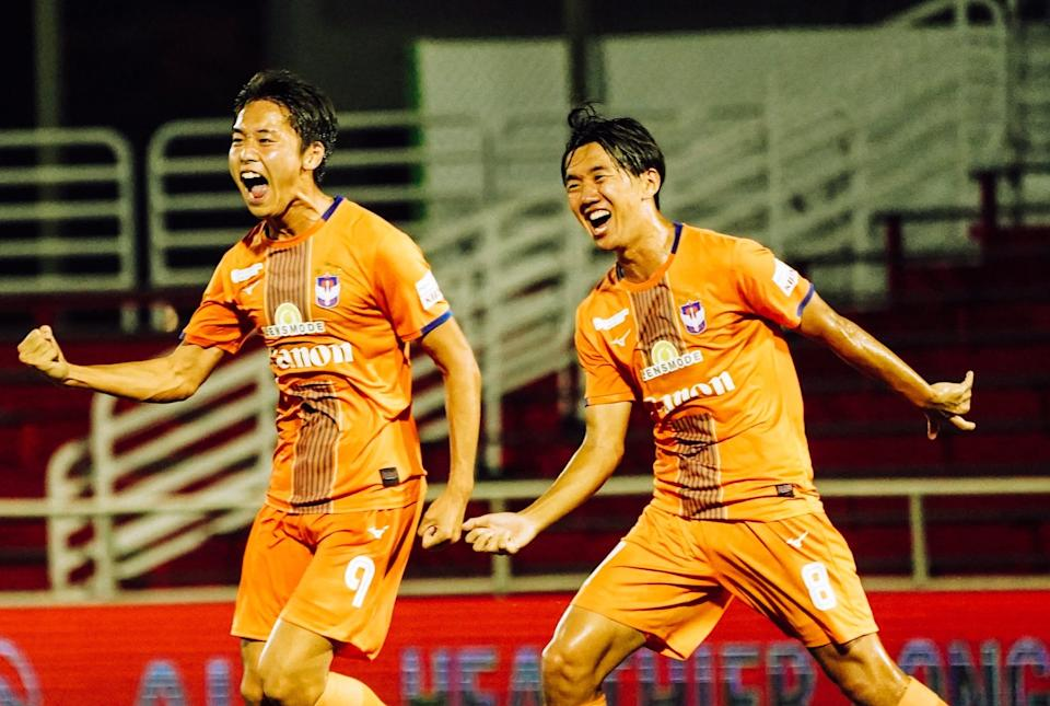 Albirex Niigata forward Kiyoshiro Tsuboi (left) celebrates scoring against Hougang United. (PHOTO: Singapore Premier League/Facebook)