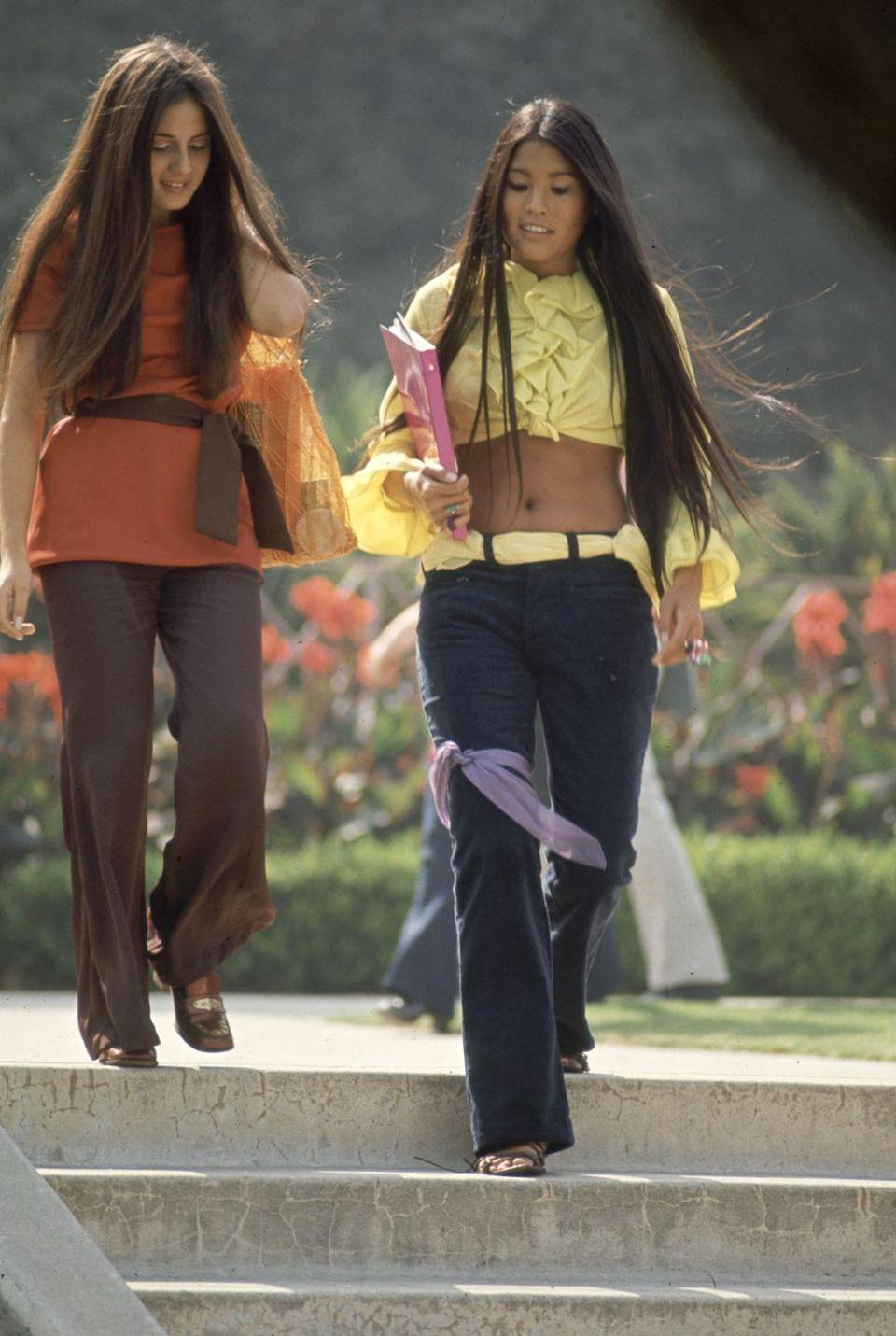 <p>Low-rise denim, as seen here on a pair of southern California high school students, was all the rage.</p>
