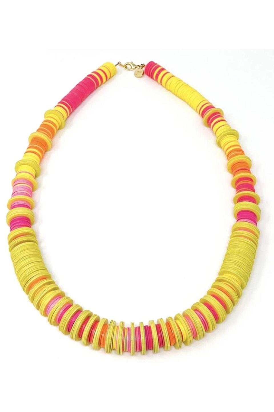 """<p><strong>Elsie Frieda</strong></p><p>elsiefrieda.com</p><p><strong>$255.00</strong></p><p><a href=""""https://elsiefrieda.com/collections/necklaces-by-elsie-frieda/products/copy-of-the-ranny-collection-black-fushia-blush-necklace"""" rel=""""nofollow noopener"""" target=""""_blank"""" data-ylk=""""slk:Shop Now"""" class=""""link rapid-noclick-resp"""">Shop Now</a></p><p>Go bold for the summer with this necklace by Elsie Frieda. It'll look amazing with a maxi dress or a white tee shirt. </p>"""