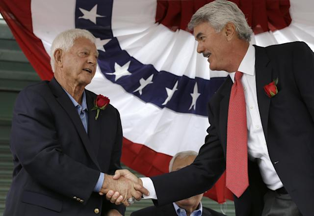 Baseball Hall of Famer Carl Yastrzemski, left, shakes hands with former Boston Red Sox's Dwight Evans, right, during a ceremony held to unveil a statue of Yastrzemski Sunday, Sept. 22, 2013, at Fenway Park in Boston. (AP Photo/Steven Senne)