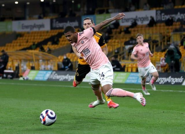Rhian Brewster was booked in a controversial first-half incident at Molineux