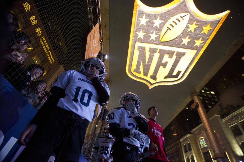 Youths take part in a football game at an NFL publicity event in Beijing. The NFL has been aggressively promoting football in China hoping to take advantage of rising income and growing taste for exotic foreign sports. (AP)