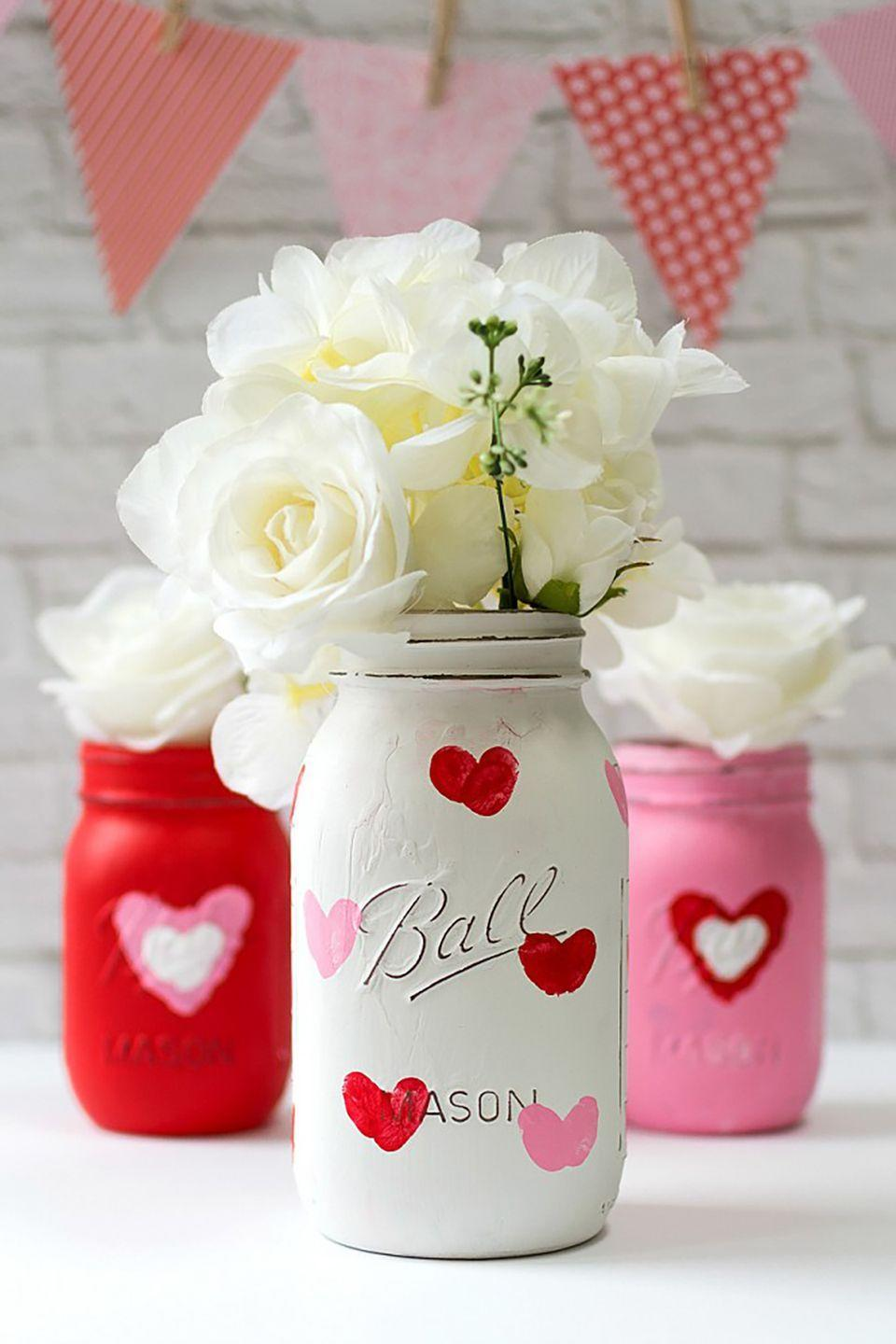 """<p>Adding thumbprints to red and white mason jars turns them into a timeless gift. Kids will love helping out with this craft, too!</p><p><strong>Get the tutorial at <a href=""""http://www.itallstartedwithpaint.com/valentine-kid-craft-thumbprint-heart-jars/?utm_source=feedburner&utm_medium=email&utm_campaign=Feed:+ItAllStartedWithPaint+(it+all+started+with+paint)&crlt.pid=camp.uK4pKHKwi4DU"""" rel=""""nofollow noopener"""" target=""""_blank"""" data-ylk=""""slk:It All Started With Paint"""" class=""""link rapid-noclick-resp"""">It All Started With Paint</a>.</strong></p><p><strong><a class=""""link rapid-noclick-resp"""" href=""""https://www.amazon.com/Magicfly-Acrylic-Paint-Set-Multi-Surface/dp/B07P9Y1DJ8/ref=sr_1_1_sspa?tag=syn-yahoo-20&ascsubtag=%5Bartid%7C10050.g.93%5Bsrc%7Cyahoo-us"""" rel=""""nofollow noopener"""" target=""""_blank"""" data-ylk=""""slk:SHOP PAINT"""">SHOP PAINT</a><br></strong></p>"""