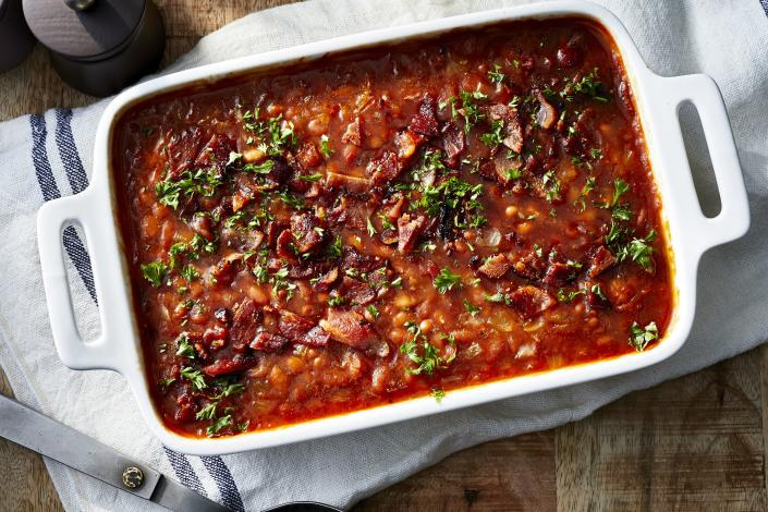 "<p><b>Recipe: </b><a href=""https://www.southernliving.com/recipes/baked-beans"" rel=""nofollow noopener"" target=""_blank"" data-ylk=""slk:Baked Beans"" class=""link rapid-noclick-resp""><b>Baked Beans</b></a></p> <p>These slightly-smoky Baked Beans pair well with anything coming off the grill. </p>"