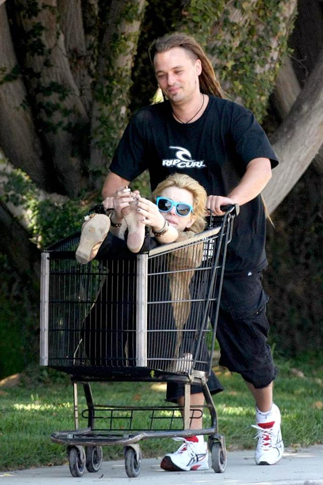 "Come to think of it, maybe it isn't such a surprise to see Courtney Love riding through Malibu in a shopping cart pushed by a man with a mullet. John Calabrese/<a href=""http://www.pacificcoastnews.com/"" target=""new"">PacificCoastNews.com</a> - June 28, 2008"
