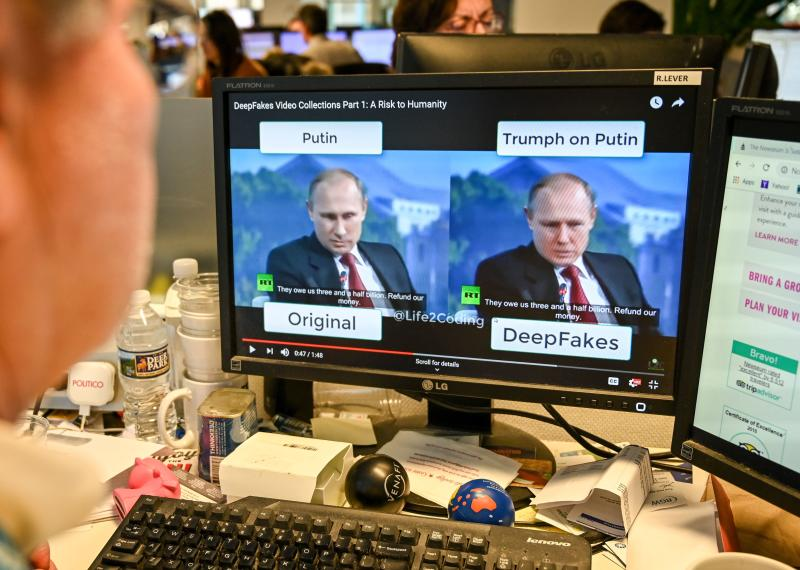 "A AFP journalist views a video on January 25, 2019, manipulated with artificial intelligence to potentially deceive viewers, or ""deepfake"" at his newsdesk in Washington, DC. - ""Deepfake"" videos that manipulate reality are becoming more sophisticated and realistic as a result of advances in artificial intelligence, creating a potential for new kinds of misinformation with devastating consequences. (Photo by Alexandra ROBINSON / AFP) / TO GO WITH AFP STORY by Rob LEVER ""Misinformation woes may multiply with deepfake videos"" (Photo credit should read ALEXANDRA ROBINSON/AFP/Getty Images)"