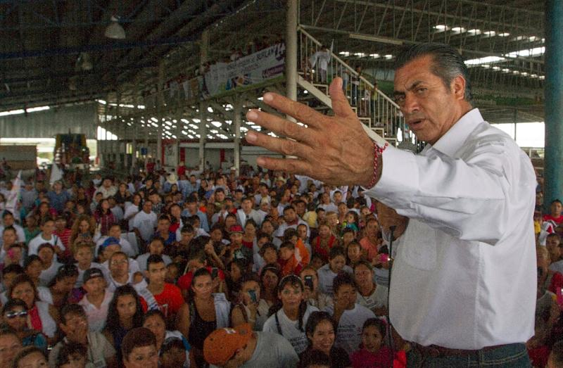 """Mexico's new Governor of Nuevo Leon State, Jaime Rodriguez Calderon aka """" El Bronco"""", won nearly 49 percent of the vote, compared to 23.6 percent for the candidate of the ruling Institutional Revolutionary Party (PRI) (AFP Photo/Julio Cesar Aguilar)"""