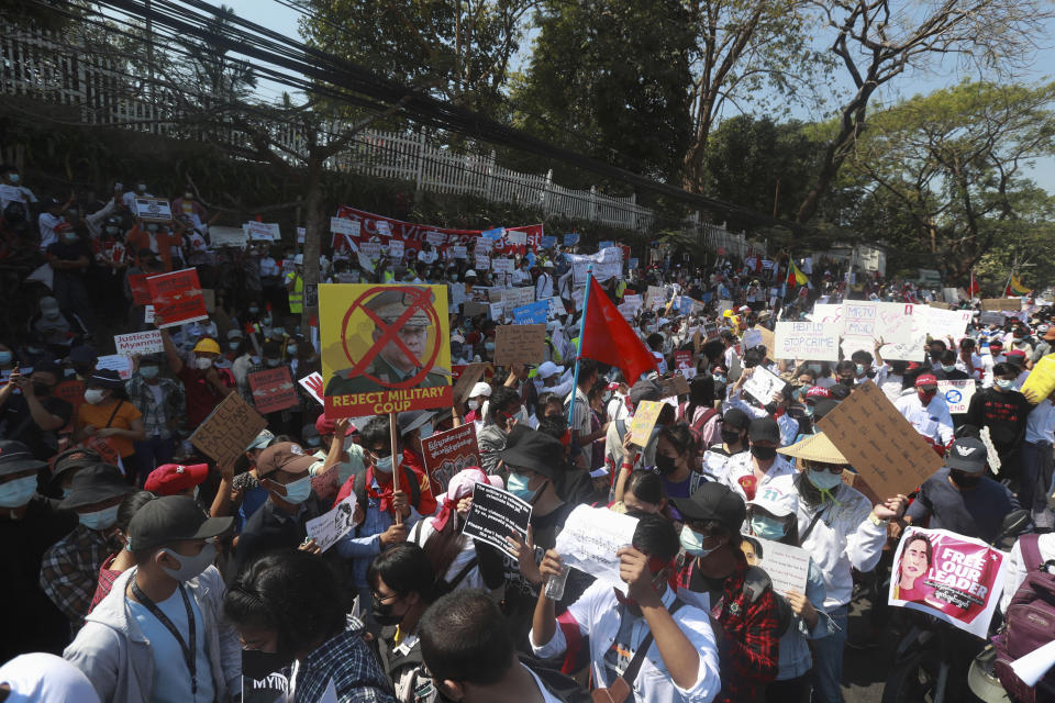 Anti-coup protesters gather outside U.S. Embassy in Yangon, Myanmar, Saturday, Feb. 13, 2021. Mass street demonstrations in Myanmar have entered their second week with neither protesters nor the military government they seek to unseat showing any signs of backing off from confrontations. (AP Photo)
