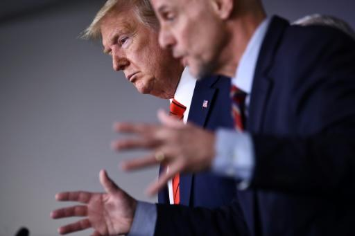 US President Donald Trump listens to FDA Commissioner Stephen Hahn (R) speak on the latest developments of the coronavirus outbreak