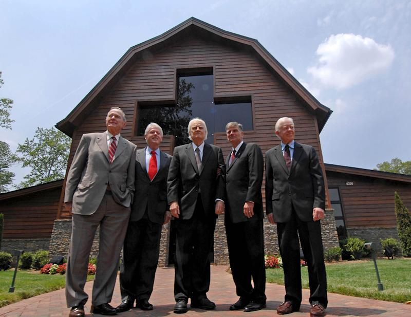 George H.W. Bush, Bill Clinton, Billy Graham, Franklin Graham, and Jimmy Carter, attend the dedication ceremony for the Billy Graham Library in Charlotte, North Carolina in 2007.