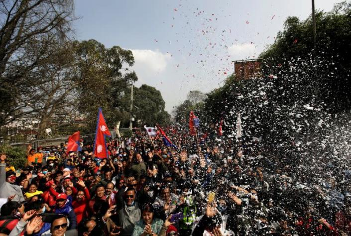 Supporters of a faction of the ruling Nepal Communist Party take part in a rally celebrating the reinstatement of the parliament by Nepal's top court in Kathmandu