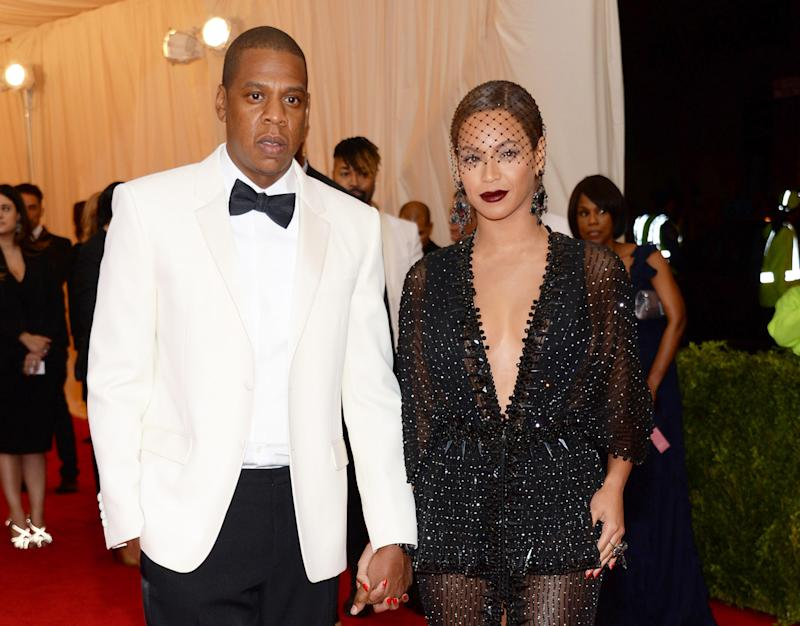 "FILE - This May 5, 2014 file photo shows Jay Z, left, and Beyonce at The Metropolitan Museum of Art's Costume Institute benefit gala celebrating ""Charles James: Beyond Fashion"" in New York. Beyonce, Jay Z and Solange say they have worked through and are moving on since a video leaked this week of Solange attacking Jay Z in an elevator inside the Standard Hotel after the May 5, gala. (Photo by Evan Agostini/Invision/AP, File)"