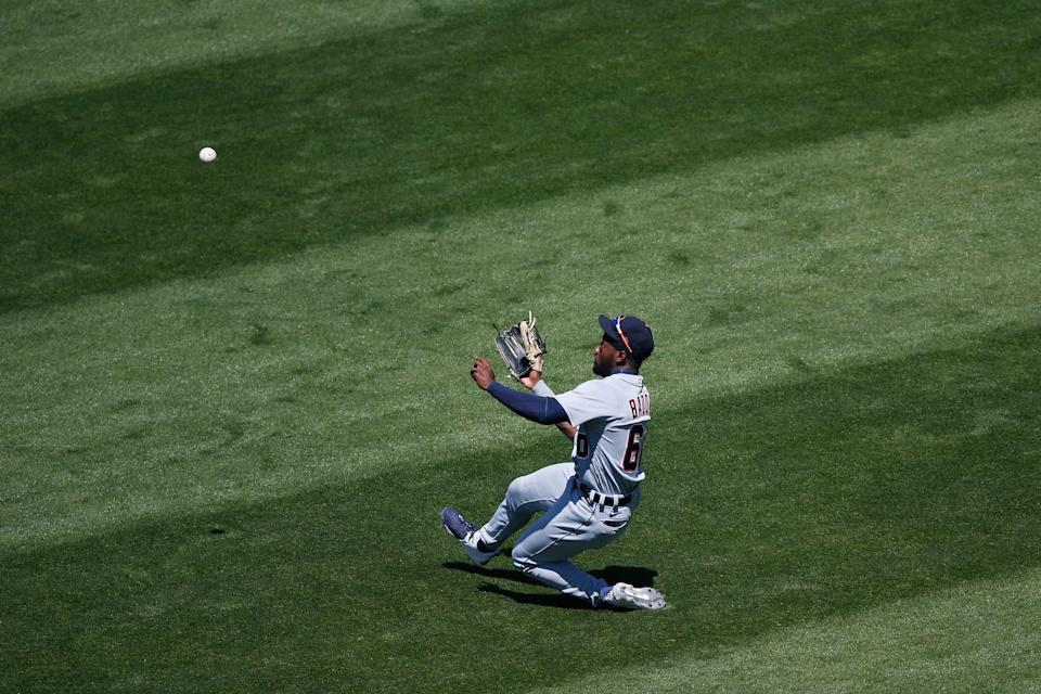 Akil Baddoo of the Detroit Tigers catches a fly ball hit by Jed Lowrie of the Oakland Athletics in the bottom of the first inning in Oakland, Calif., on Sunday, April 18, 2021.