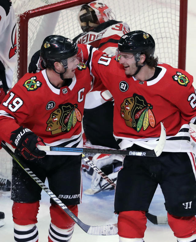 Chicago Blackhawks left wing Brandon Saad, right, smiles as he celebrates with center Jonathan Toews after scoring a goal against the New Jersey Devils during the third period of an NHL hockey game Thursday, Feb. 14, 2019, in Chicago. (AP Photo/Nam Y. Huh)