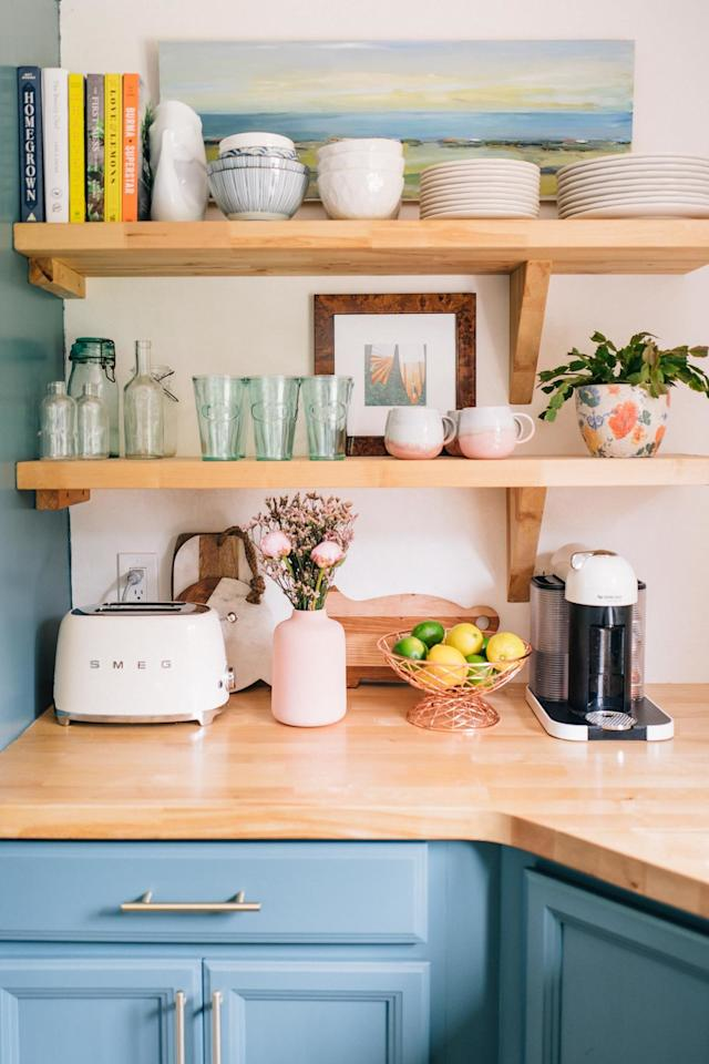 """<p>Take advantage of that extra vertical space while displaying some of your prettiest housewares. Floating shelves are a cinch to install if you have the right hardware. Blogger Jess Kirby of <a href=""""http://www.jessannkirby.com/2018/06/our-kitchen-a-year-later.html"""" target=""""_blank"""">JessAnnKirby.com</a> used leftover butcher block to make these beauties. If your landlord makes you take them down before you move, you can patch the small holes easily, too.</p> <p><strong>RELATED: <a href=""""https://www.realsimple.com/home-organizing/decorating/decorating-bathroom/bathroom-shelf-ideas-open-shelving"""" target=""""_blank"""">The Trending Bathroom Shelf Idea You're Going to Want to Try This Year</a></strong></p>"""