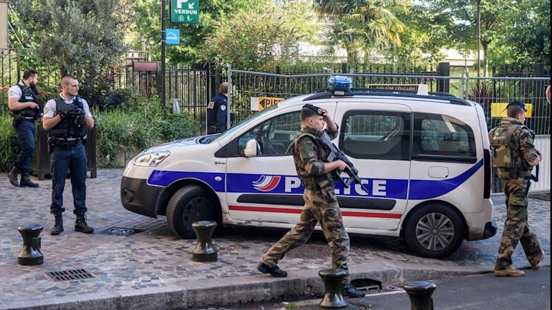 French police are searching for a driver who slammed his BMW into a group of soldiers in Paris.