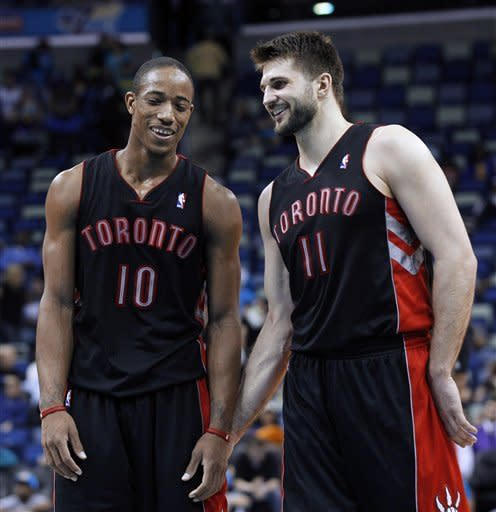Toronto Raptors guard DeMar DeRozan (10) and forward Linas Kleiza (11) talk near the end of an NBA basketball game against the New Orleans Hornets in New Orleans, Wednesday, Feb. 29, 2012. The Raptors won 95-84. (AP Photo/Bill Haber)