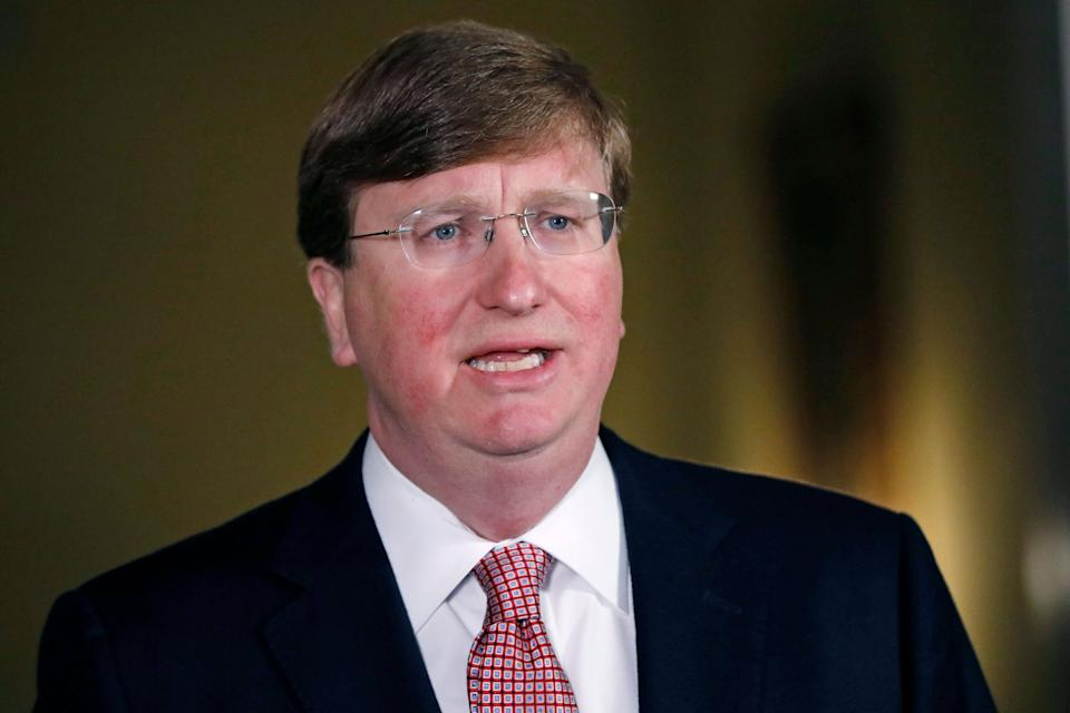 Mississippi Republican Gov. Tate Reeves delivers a televised address prior to signing a bill retiring the last state flag with the Confederate battle emblem during a ceremony at the Governor's Mansion in Jackson, Mississippi, on June 30, 2020. Upon signing the bill, the flag looses its official status. - Lawmakers in Mississippi voted June 28 to remove the Confederate battle standard from the state flag, after nationwide protests drew renewed attention to symbols of the United States' racist past. The measure passed with a 91-23 majority vote in the House of Representatives, triggering cheers in the Senate gallery. A few hours later, the Senate voted 37-14 for the bill. (Photo by Rogelio V. Solis / POOL / AFP) (Photo by ROGELIO V. SOLIS/POOL/AFP via Getty Images) (Photo: ROGELIO V. SOLIS via Getty Images)