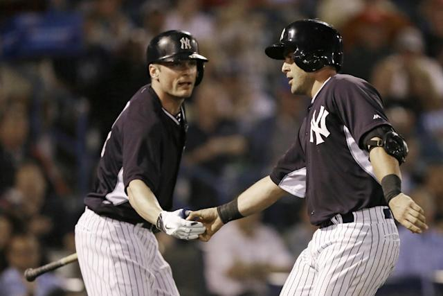 New York Yankees' Francisco Cervelli, right, is greeted by teammate Brendan Ryan after hitting a home run in the second inning of an exhibition baseball game against the Baltimore Orioles Tuesday, March 4, 2014, in Tampa, Fla. (AP Photo/Charlie Neibergall)