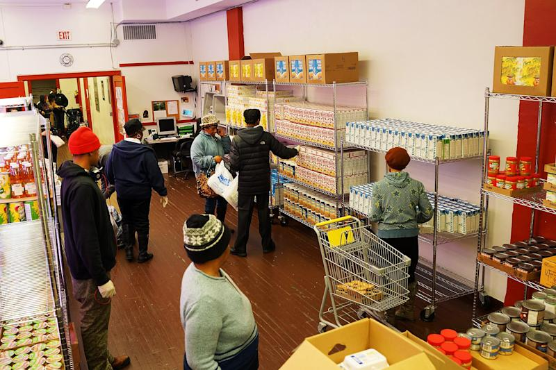 People collect food on February 18, 2014 in the Brooklyn borough of New York