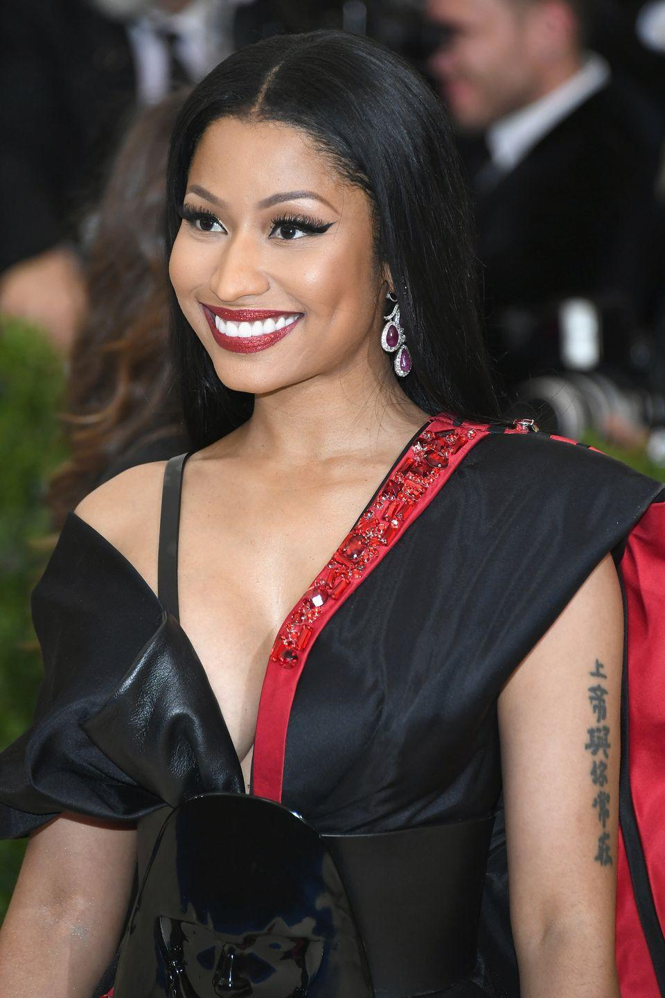 """<p>Yes, even The Queen sometimes has regrets. Nicki Minaj was 16 when she got the Chinese characters that read """"God is with me always"""" on her arm, but now that she's older, she's having second thoughts about the ink, <em><a href=""""https://www.elle.com.au/beauty/celebrity-tattoo-regrets-20910"""" rel=""""nofollow noopener"""" target=""""_blank"""" data-ylk=""""slk:Elle Australia"""" class=""""link rapid-noclick-resp"""">Elle Australia</a></em> reports. """"You have no idea what you want to put on your body at the age of 16,"""" the Grammy nominee reportedly said in an interview. """"You need to wait until at least 21 and decide.""""</p>"""