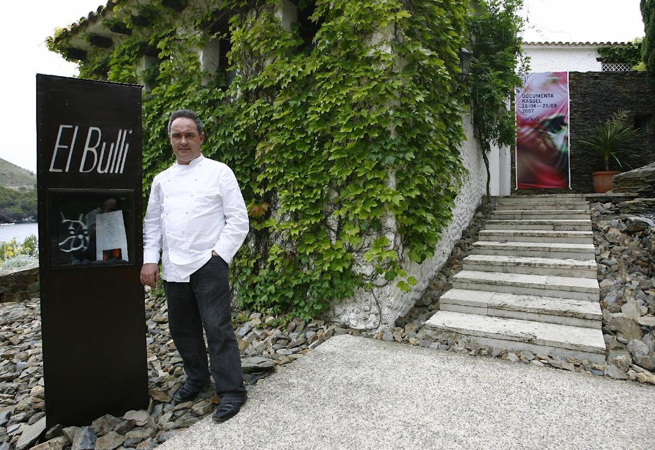 Spanish Chef Ferran Adria posing in front of shuttered El Bulli restaurant in Roses, northern Spain
