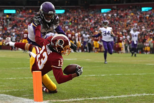 <p>Wide receiver Maurice Harris #13 of the Washington Redskins catches a touchdown pass in front of cornerback Trae Waynes #26 of the Minnesota Vikings during the first quarter at FedExField on November 12, 2017 in Landover, Maryland. (Photo by Patrick Smith/Getty Images) </p>