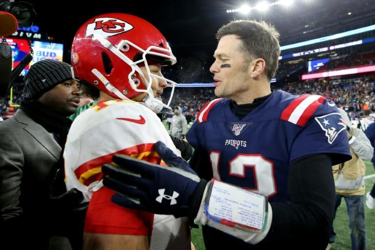 Patrick Mahomes (left) and Tom Brady (right) exchange words after the 2019 game between Kansas City and New England