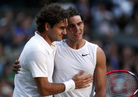FILE PHOTO: Rafael Nadal of Spain (R) is embraced by Roger Federer of Switzerland after defeating him in their finals match at the Wimbledon tennis championships in London, Britain, July 6, 2008. REUTERS/Pool/File Photo