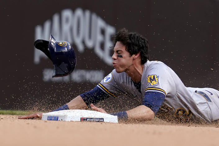 Milwaukee Brewers' Christian Yelich steals second base during the eighth inning of a baseball game against the Chicago Cubs in Chicago, Wednesday, April 7, 2021. (AP Photo/Nam Y. Huh)