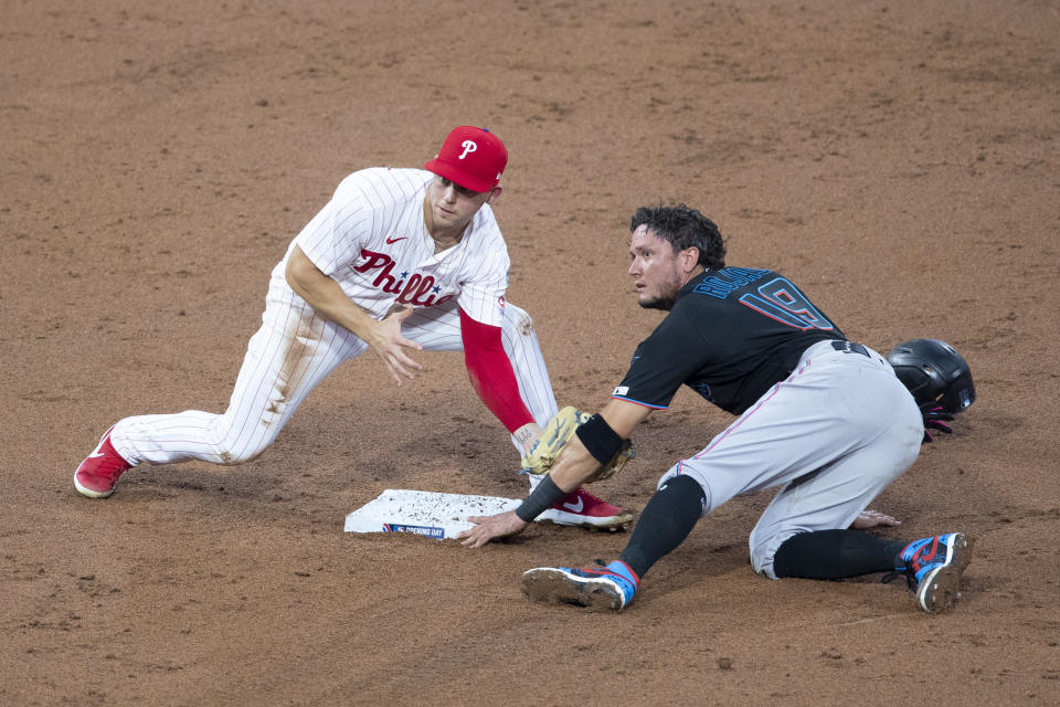 PHILADELPHIA, PA - JULY 24: Miguel Rojas #19 of the Miami Marlins steals second base past Scott Kingery #4 of the Philadelphia Phillies in the top of the third inning during Opening Day at Citizens Bank Park on July 24, 2020 in Philadelphia, Pennsylvania. The 2020 season had been postponed since March due to the COVID-19 pandemic. The Marlins defeated the Phillies 5-2. (Photo by Mitchell Leff/Getty Images)