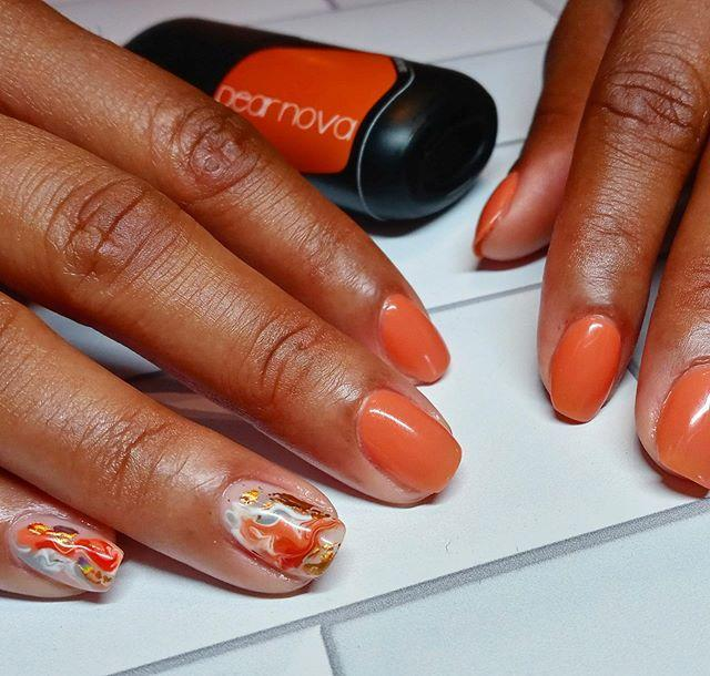 """<p>We'll be the first to admit water marbling your nails is trickier than it looks. So, keep the painterly effect to just one or two nails as accents, then go with a punchy orange for the rest—you'll thank us later. </p><p><a href=""""https://www.instagram.com/p/CCW5WFfFSSk/"""" rel=""""nofollow noopener"""" target=""""_blank"""" data-ylk=""""slk:See the original post on Instagram"""" class=""""link rapid-noclick-resp"""">See the original post on Instagram</a></p>"""
