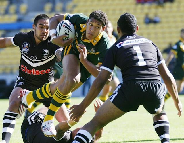 Israel Folau on the charge while playing rugby league for Australia against New Zealand (AFP Photo/DEAN TREML)