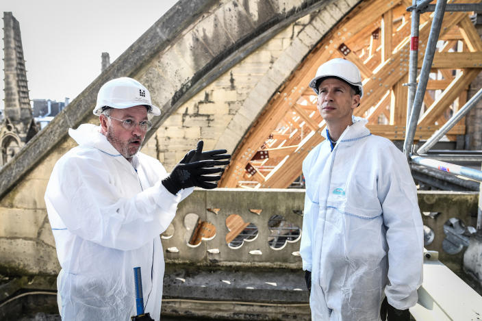 French Culture Minister Franck Riester, right, listens to French chief architect of historical sites Philippe Villeneuvethe Notre Dame Cathedral three months after a major fire July 17, 2019 in Paris. (Photo: Stephane de Sakutin/Pool via AP)