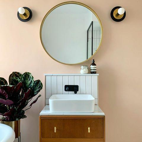 """<p>Hit refresh on your functional bathroom <a href=""""https://www.housebeautiful.com/uk/decorate/lighting/g33469959/best-smart-lights/"""" rel=""""nofollow noopener"""" target=""""_blank"""" data-ylk=""""slk:lighting"""" class=""""link rapid-noclick-resp"""">lighting</a> with stylish wall lights and sconces. Sarah adds: 'Add a touch of retro with fluted glass wall lights or pair your globe light with gold fixtures to compliment other gold accents.' </p><p><a href=""""https://www.instagram.com/p/CC6QGItnXQi/"""" rel=""""nofollow noopener"""" target=""""_blank"""" data-ylk=""""slk:See the original post on Instagram"""" class=""""link rapid-noclick-resp"""">See the original post on Instagram</a></p>"""