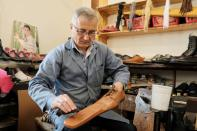 Romanian shoemaker Grigore Lup works on a pair of long-nosed leather shoes, amid the outbreak of the coronavirus disease (COVID-19), in Cluj-Napoca